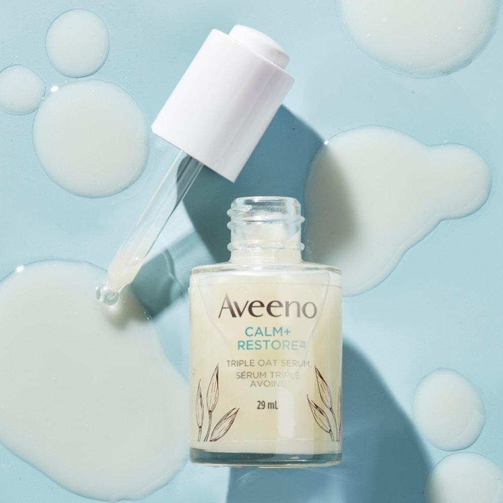 AVEENO® Calm + Restore Sensitive Skin Triple Oat Serum Open Bottle