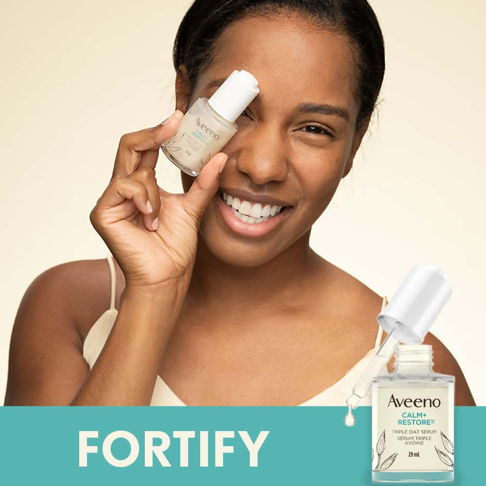 Woman Using AVEENO® Calm + Restore Sensitive Skin Triple Oat Serum to Fortify Skin
