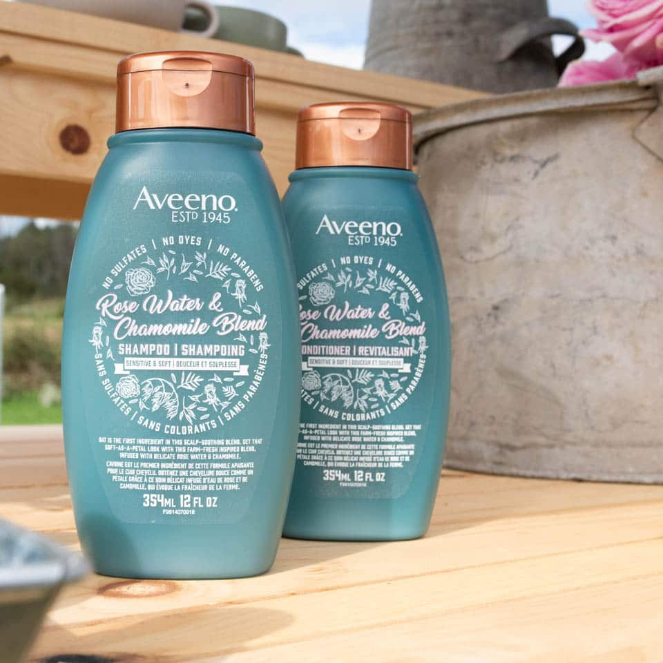two aveeno rose water chamomile product bottles
