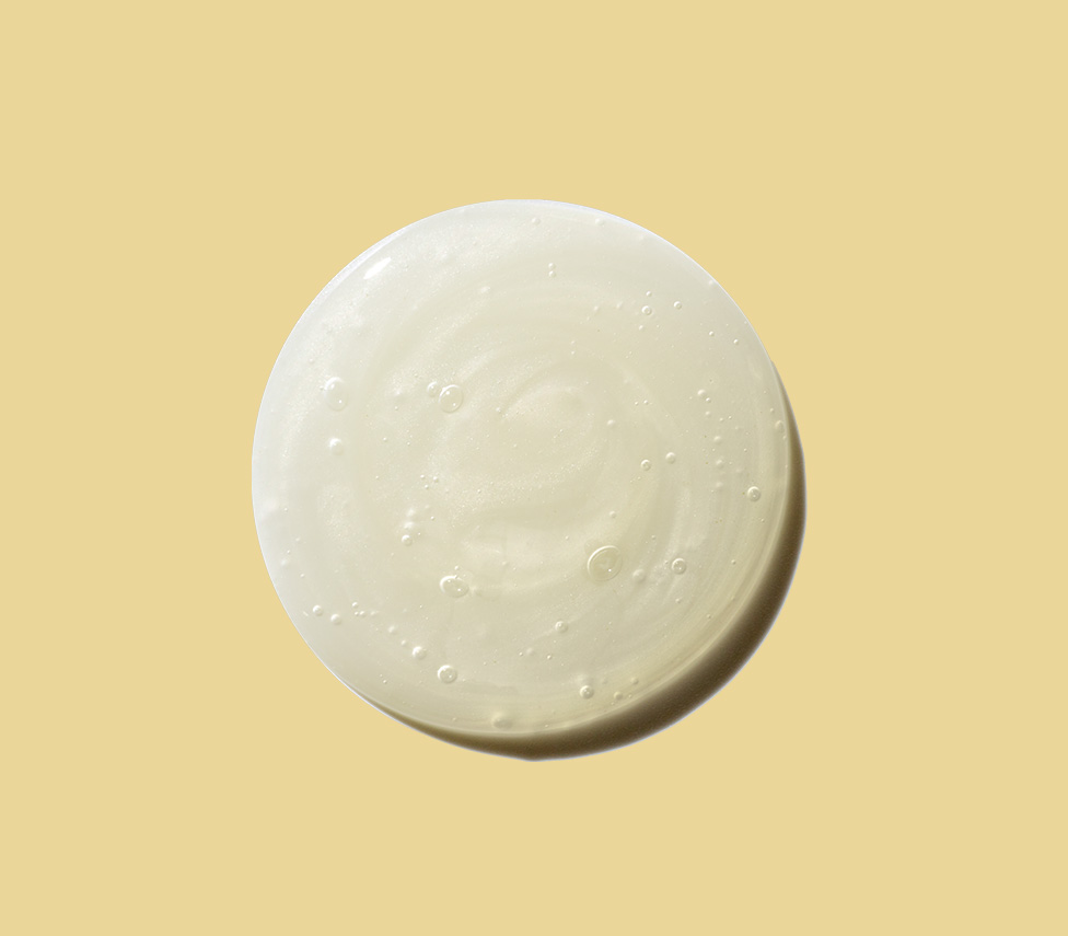 circle drop of lotion against a yellow background
